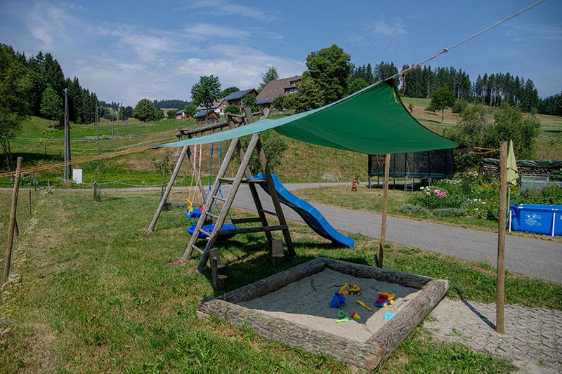 Sonnensegel Sandkasten Rutsche und Schaukel - Josenmuehle